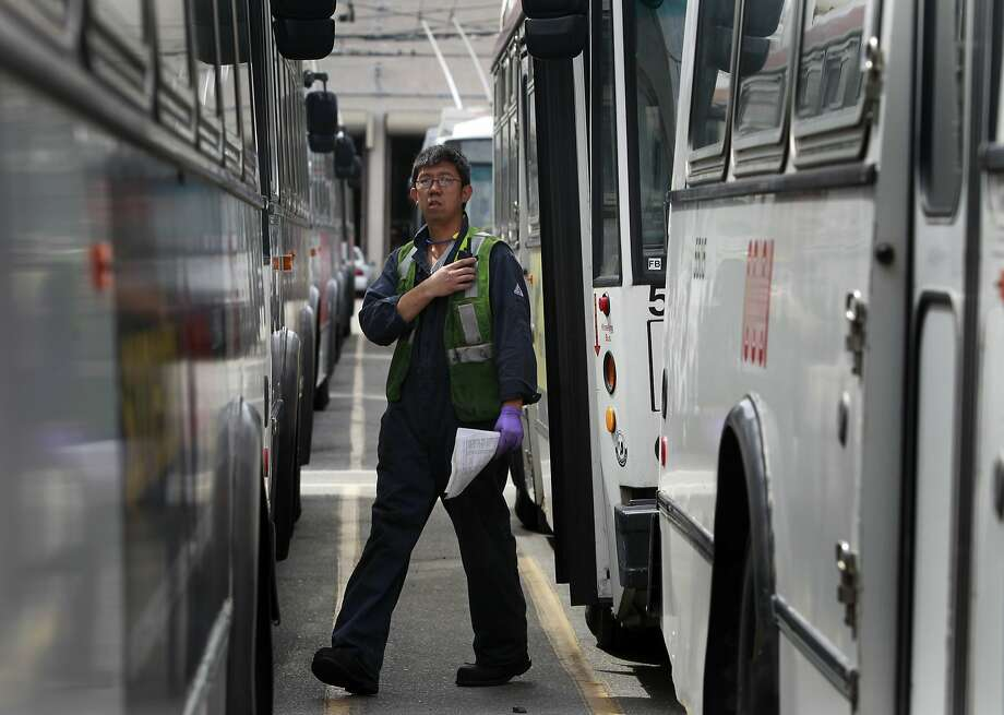 Mechanic Tommy To in Muni's Presidio Avenue maintenance yard, which hosts a fleet of 157 coaches. Photo: Paul Chinn, The Chronicle