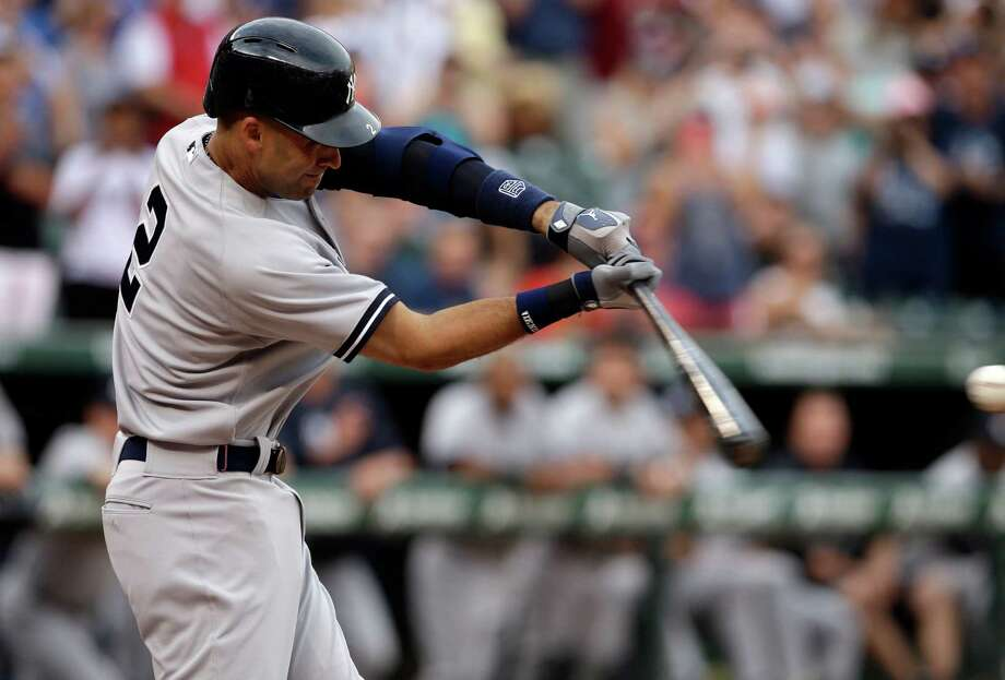 New York Yankees' Derek Jeter (2) swings at a pitch from Texas Rangers' Yu Darvish that went for a single to left in the first inning of a baseball game, Monday, July 28, 2014, in Arlington, Texas. (AP Photo/Tony Gutierrez) Photo: Tony Gutierrez, Associated Press / AP