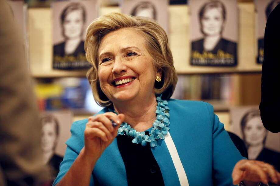 """Hillary Rodham Clinton signs copies of her new book """"Hard Choices"""" at the Common Good Books store, Sunday July 20, 2014 in St Paul, Minn. (AP Photo/The Star Tribune, Jerry Holt) ORG XMIT: MNMIT501 Photo: Jerry Holt / The Star Tribune"""