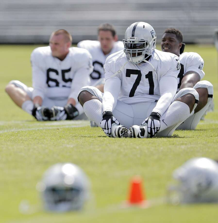 Menelik Watson (71) learned about taking care of his body last season, when he played only five games. Photo: Carlos Avila Gonzalez, The Chronicle