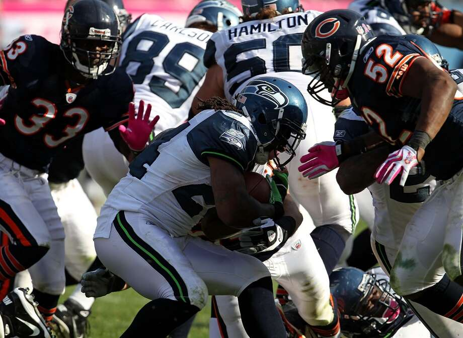 In 2010, after four games with the Bills, Lynch was traded to the Seahawks in exchange for two future draft picks -- a fourth-round selection in 2011 and a conditional pick in 2012. Lynch made an immediate impact with Seattle, and on Dec. 5, 2010, he scored three touchdowns against the Carolina Panthers. Photo: Jonathan Daniel, Getty Images
