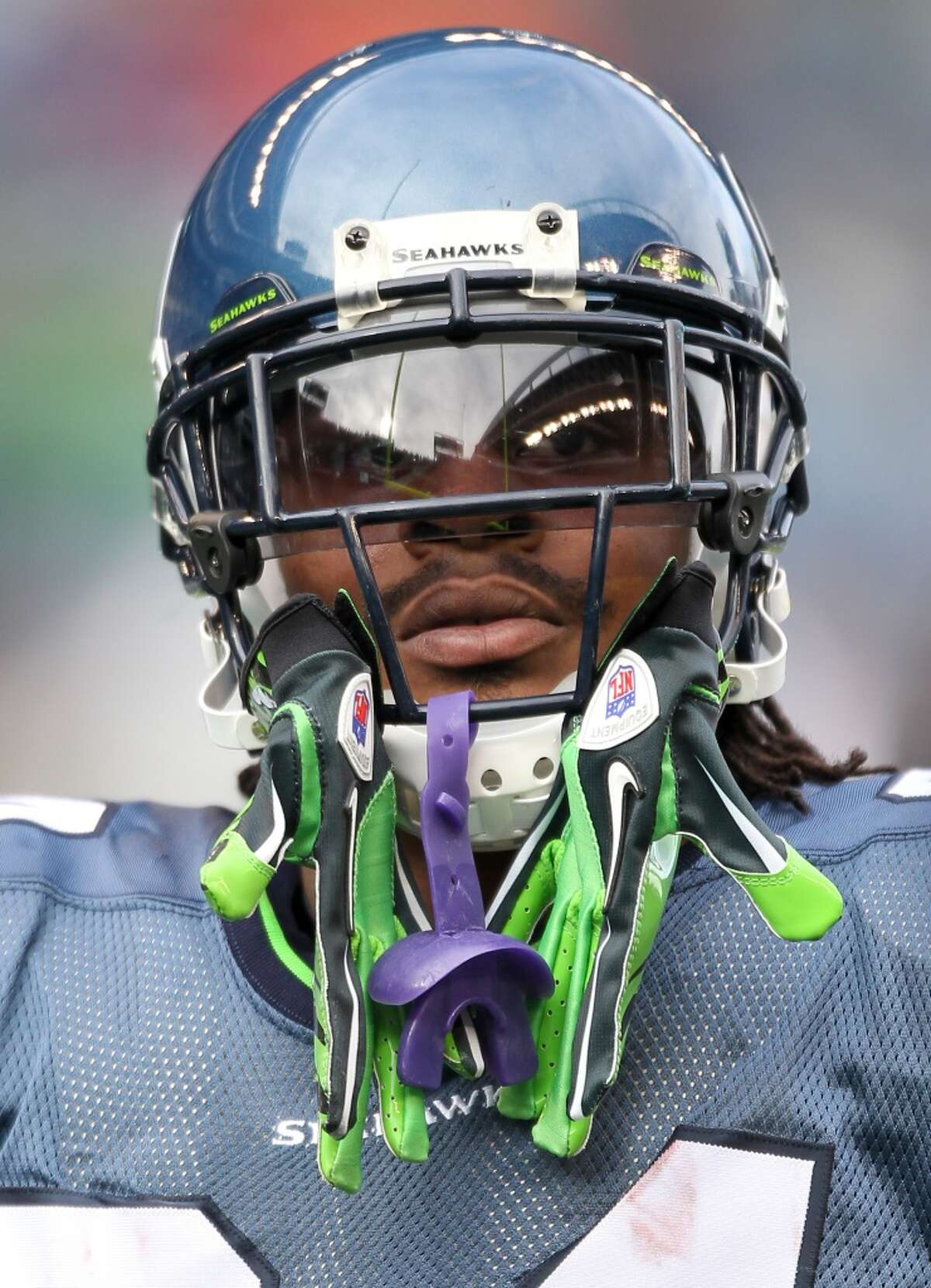 This look -- Lynch's gloves hanging out of his facemask -- soon became a familiar sight at CenturyLink Field. But he didn't prove himself to Seattle's 12th Man until the playoffs that 2010 season.