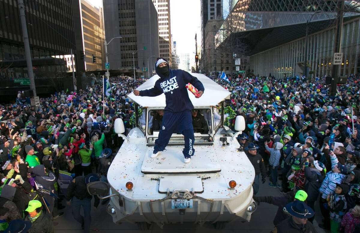 Back in Seattle, Lynch put on a show for the 12th Man during the Seahawks' Super Bowl victory parade. Riding on the hood of a Ride the Ducks vehicle, Lynch threw Skittles to the crowd, took swigs of Fireball whiskey and banged on a ceremonial American-Indian drum he snagged from a fan.