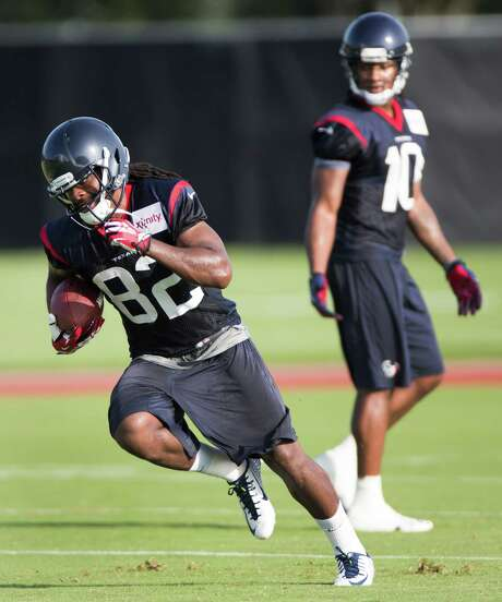 Texans wide receiver Keshawn Martin (82) continues to earn high marks from coach Bill O'Brien as he competes for the No. 3 slot position against DeVier Posey and Mike Thomas. Photo: Brett Coomer, Staff / © 2014 Houston Chronicle