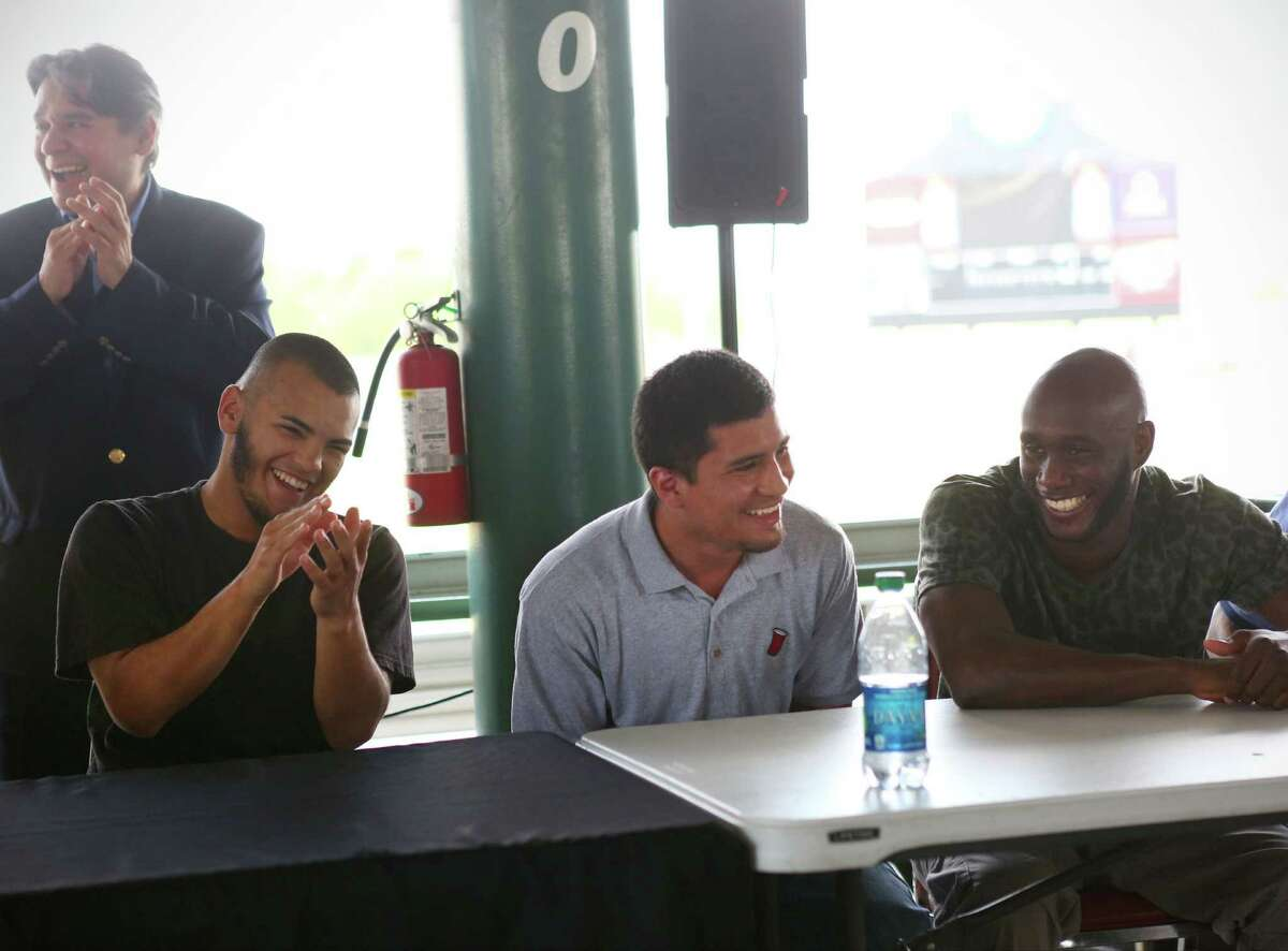 Javier Rodriguez (from left), Adam Lopez and Benjamin Whitaker laugh during the