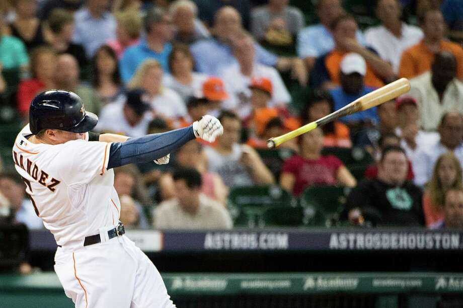 Astros center fielder Kiké Hernandez loses his bat on a swing during the third against the A's. Hernandez went 1-for-2 with a walk to raise his average to .274. Photo: Smiley N. Pool / © 2014  Smiley N. Pool