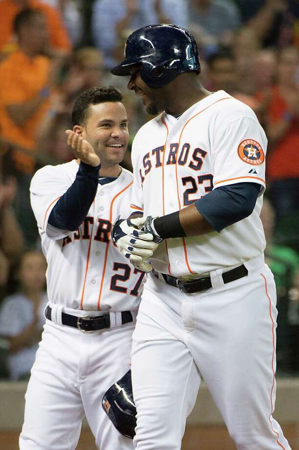 Houston Astros designated hitter Chris Carter celebrates with second baseman Jose Altuve after hitting a 3-run home run during the third inning against the Oakland Athletics at Minute Maid Park on Monday, July 28, 2014, in Houston. Photo: Smiley N. Pool, Houston Chronicle / © 2014  Smiley N. Pool