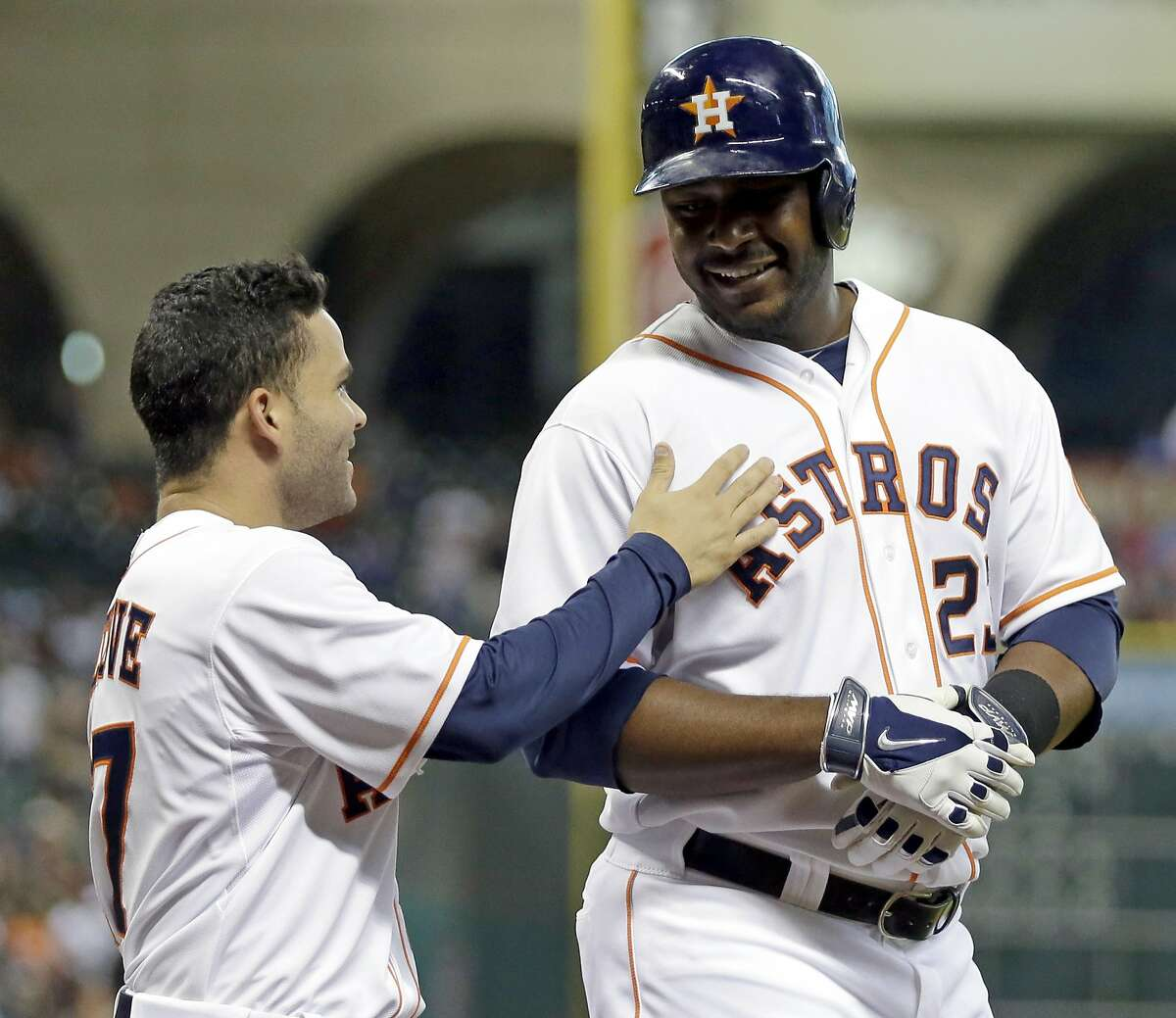 Houston Astros' Chris Carter, right, is congratulated by Jose Altuve, left, after hitting a three-run home run against the Oakland Athletics during the third inning of a baseball game Monday, July 28, 2014, in Houston. Altuve and Enrique Hernandez scored on Carter's homer. (AP Photo/David J. Phillip)