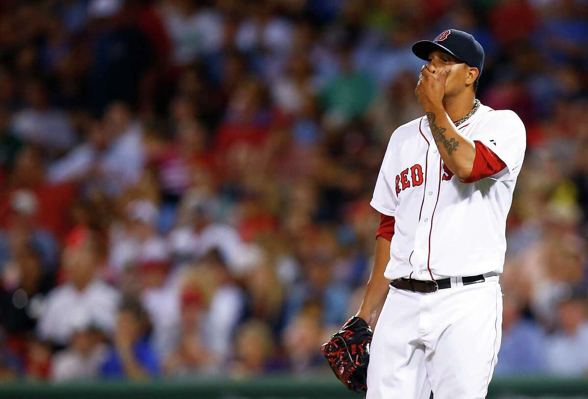 BOSTON, MA - JULY 28: Felix Doubront #22 of the Boston Red Sox reacts after giving up multiple runs in the sixth inning before being pulled against the Toronto Blue Jays during the game at Fenway Park on July 28, 2014 in Boston, Massachusetts. (Photo by Jared Wickerham/Getty Images) ORG XMIT: 477587013