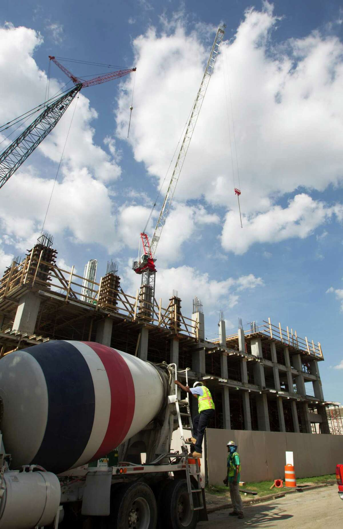 Construction crews work on a new 17 story office tower off San Felipe rd on Monday, July 28, 2014, in Houston. The tower near River Oaks has been subject to two lawsuits. ( J. Patric Schneider / For the Chronicle )
