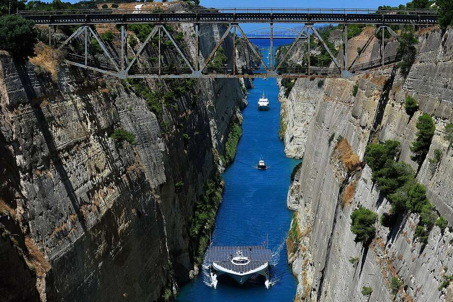 The world's largest solar-powered boat, MS Turanor PlanetSolar, sails through the Corinth Canal 