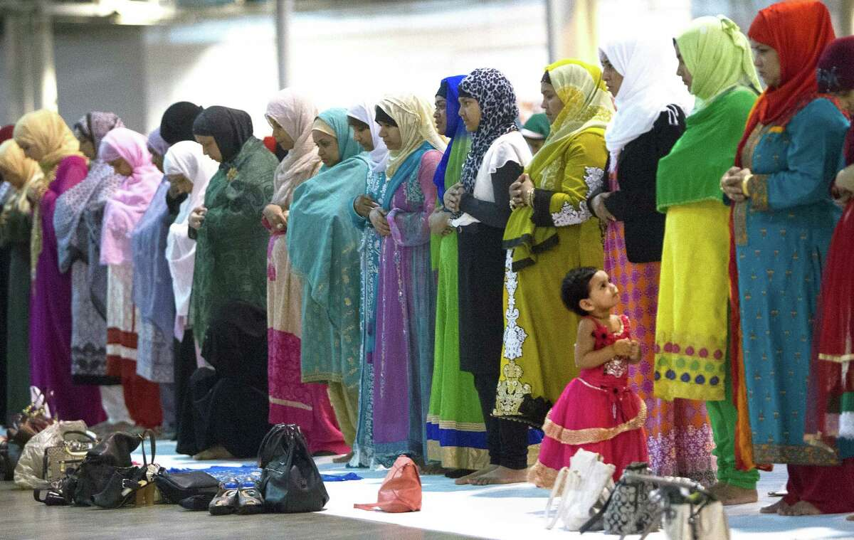 """Muslims gather to celebrate Eid al-Fitr on Monday at NRG Park. The event brought an estimated 15,000 worshippers. One attendee expressed appreciation for """"every gift from the Lord."""""""