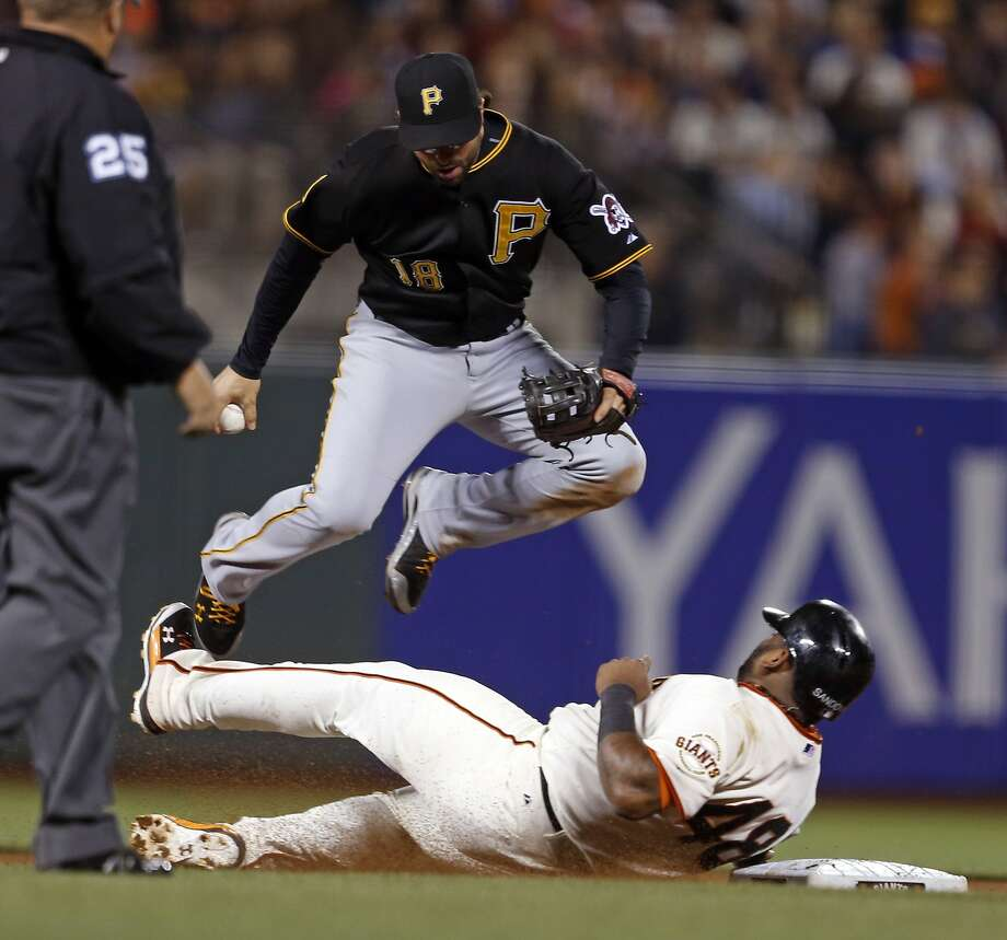 Pablo Sandoval forces Neil Walker's leap at second base, preventing a relay on a potential double play ball in the eighth. Photo: Scott Strazzante, The Chronicle