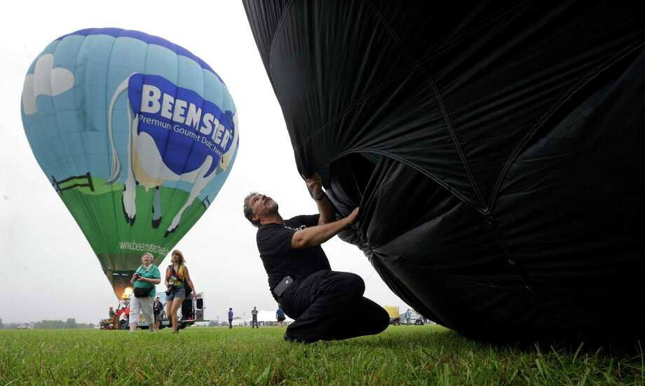 Craig Kennedy, of Elverson, Pa., prepares his hot air balloon, Wicked, for flight at the 32nd annual OuickChek New Jersey Festival of Ballooning, Sunday, July 27, 2014, in Readington, N.J.  Photo: Mel Evans, Associated Press / AP