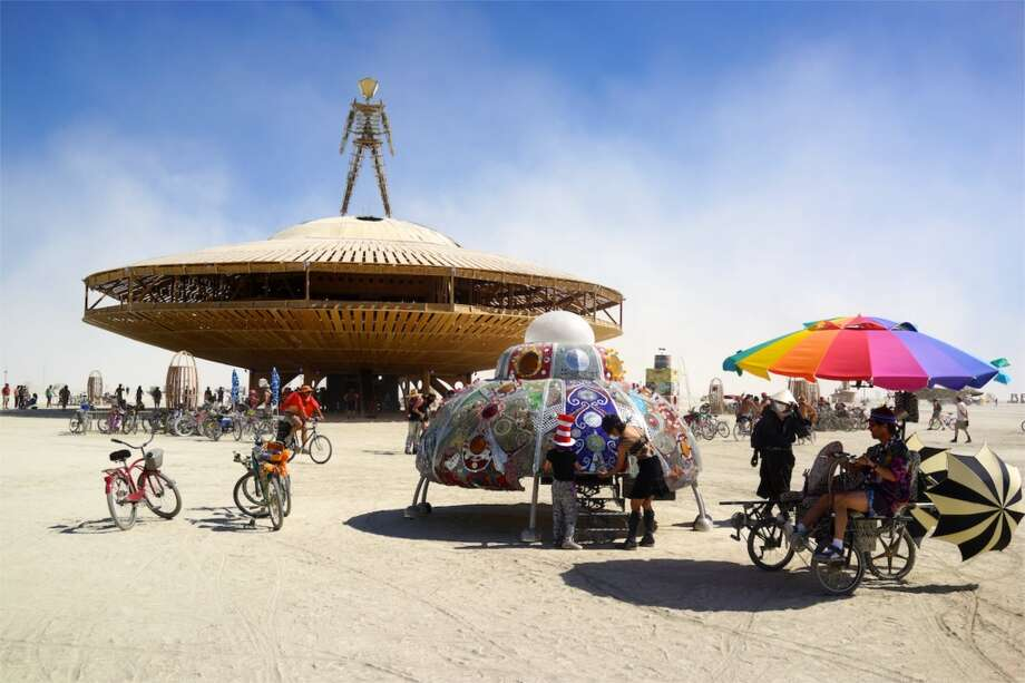 The theme WAS Cargo Cult, after all, which almost no one fully understood and which, if you cared to research it involves spacecraft, and modern tech, and aliens, and mysticism, and such. Rainbow umbrella art car thing sold separately.