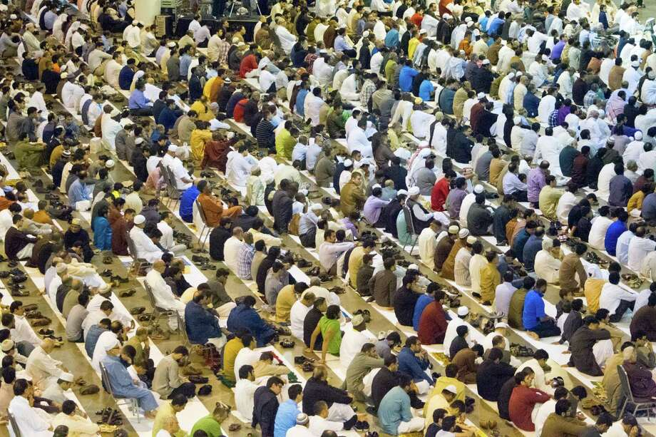 Muslims gather to celebrate Eid ul Fitr Salat at NRG Center, Monday, July 28, 2014, in Houston. The event brought close to 15,000 Muslims as they celebrated Eid, which marks the last day of Ramadan. Photo: Cody Duty, Houston Chronicle / © 2014 Houston Chronicle