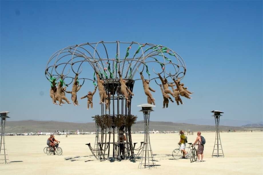 Peter Hudson's Monkeys, back from Burning Man 2007! AKA Homouroboros, Tantalus, AKA another awesome zoetrope that's far more amazing (and is obviously designed for) night viewing. I had a video of this in action, but it's lost. Perhaps go here to see what it really does? http://www.youtube.com/watch?v=ywK4kIq6OTQ