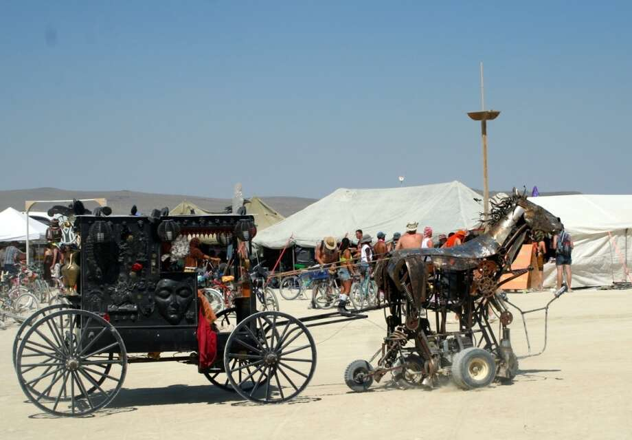 Steampunk covered wagon flamethrower art car thing? Hell, yes.