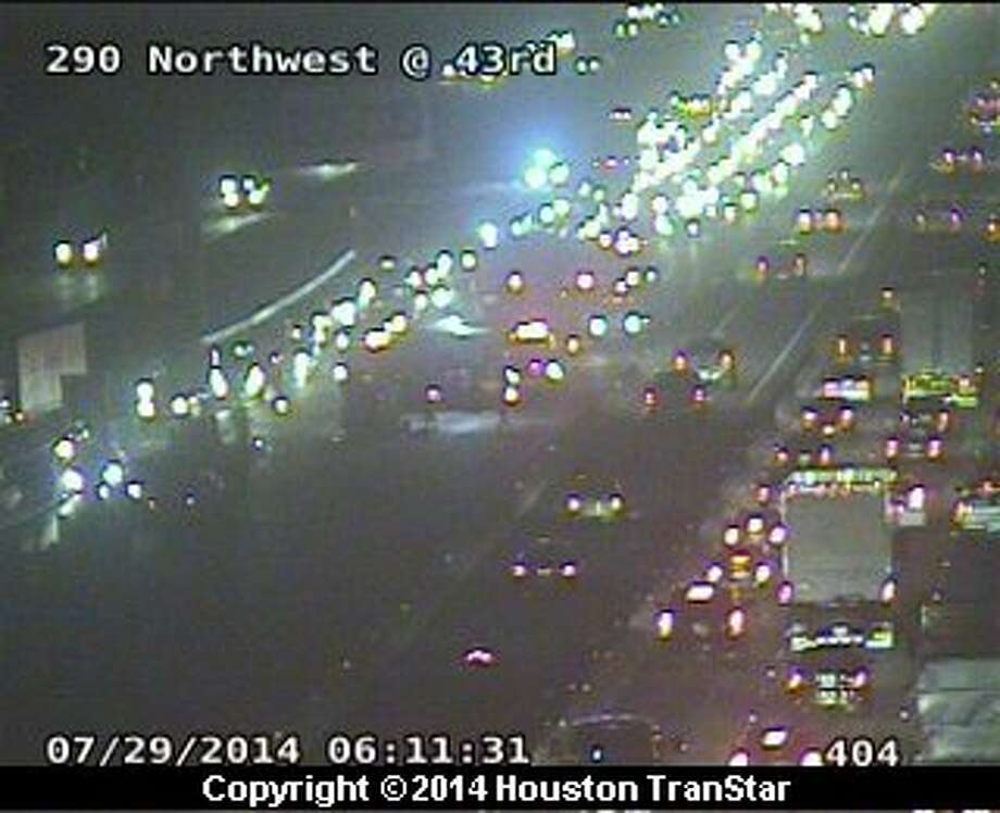 A three-vehicle wreck about 5:50 a.m. Tuesday shut the outbound Northwest Freeway near 43rd Street, according to Houston TranStar. Photo: Houston TranStar