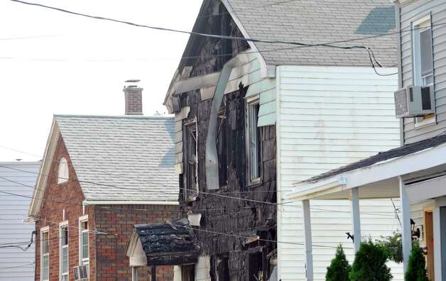 A view of the home located at 52 Walker Street damaged by fire on Tuesday, July 29, 2014, in Rensselaer, N.Y.   (Paul Buckowski / Times Union) Photo: Paul Buckowski / 00027973A