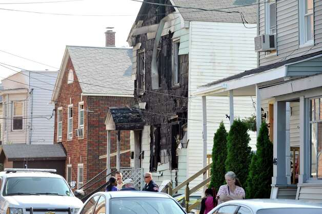 Investigators work at the scene of a fatal fire at 52 Walker Street, on Tuesday, July 29, 2014, in Rensselaer, N.Y.  (Paul Buckowski / Times Union) Photo: Paul Buckowski / 00027973A