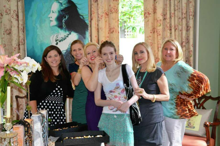 Luncheon attendees Linsey Hyatt, Fiona Cunningham, Rita Beckett, Sarah Hughes, Carolyn Farb and Marcie Berry trying on Jeanette's Jewels and supporting the Arthritis Foundation, June 14, 2014. Photo: Jeanette Korab