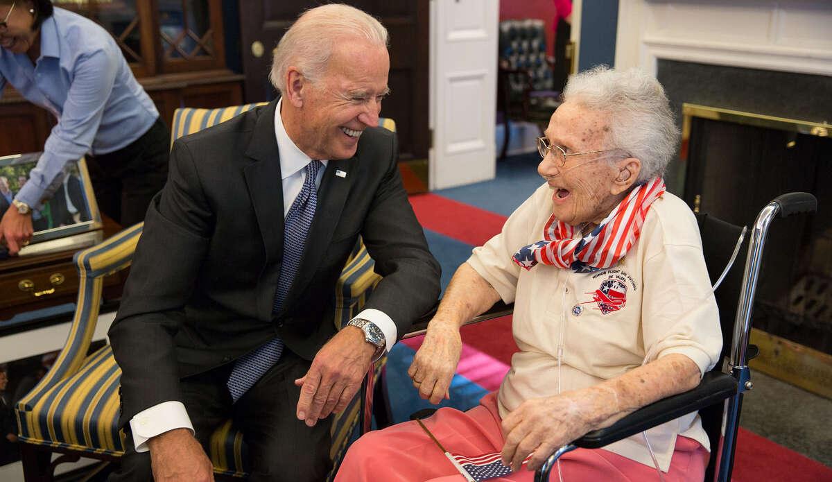Vice President Joe Biden greets Lucy Coffey, 108, the oldest living female veteran, Friday.
