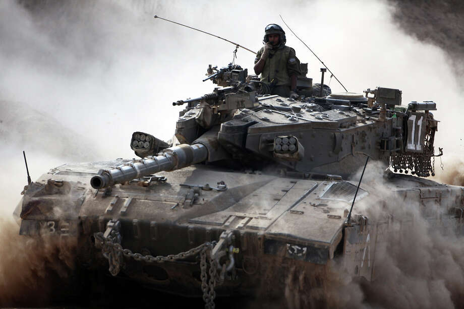 An Israeli army Merkava tank rolls along the border between Israel and the Hamas-controlled Gaza Strip on July 28, 2014. The UN Security Council joined US President Barack Obama in calling for an immediate ceasefire in Gaza, after Israel and Hamas ignored calls for a truce despite mounting civilian casualties. Photo: DAVID BUIMOVITCH, AFP/Getty Images / AFP