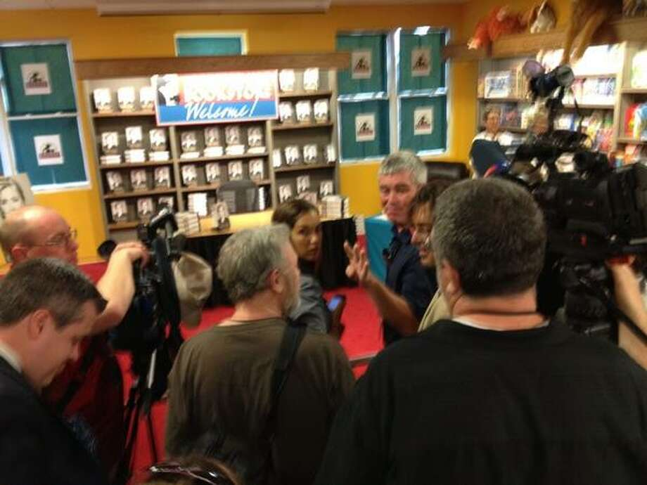 "Repoters and photographers gather inside Northshire Bookstore where Hillary Rodham Clinton is expected to sign copies of her book, ""Hard Choices,"" on Tuesday. (Paul Grondahl / Times Union)"
