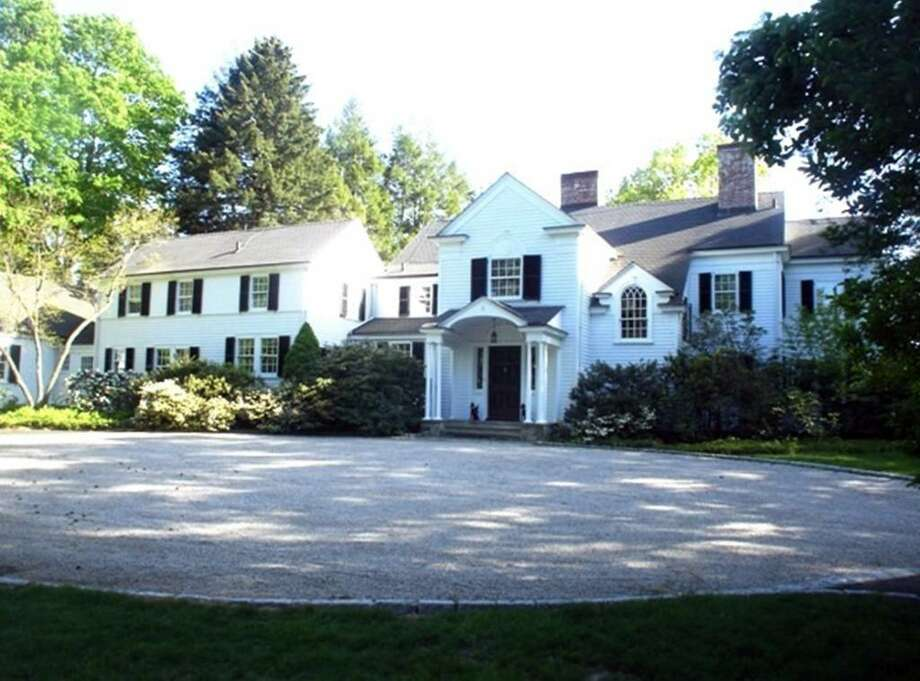 The 1930 Colonial Revival house in North Stamford has some 5,500 square feet, 15 rooms and six bedrooms inside. The huge foyer has a fireplace, as does the living room and den. The random-width oak floors have been restored, and the original moldings and details retained. The 3.16 acres could be subdivided into three lots, with the main house on one, two-bedroom guest house on another and the third facing a different street.     It is listed at $1.935 million. Photo: Contributed Photo / Stamford Advocate Contributed