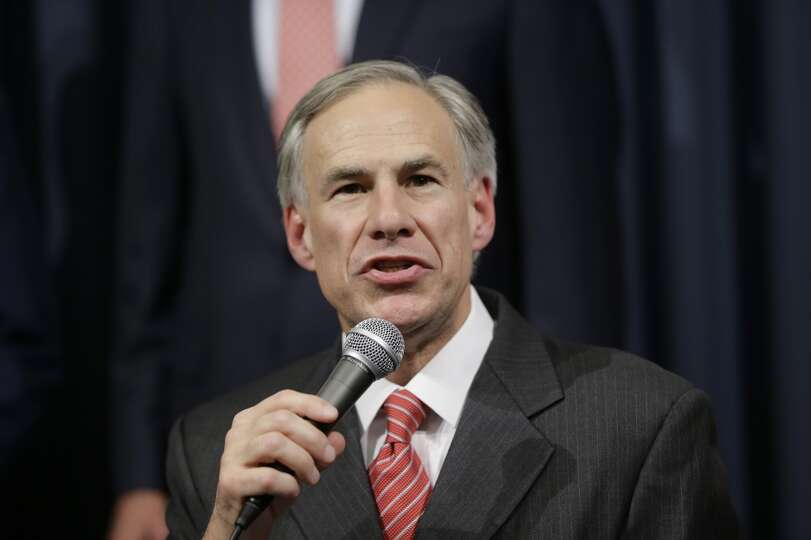 Texas Attorney General Greg Abbott speaks during a news conference with Gov. Rick Perry in the Gover