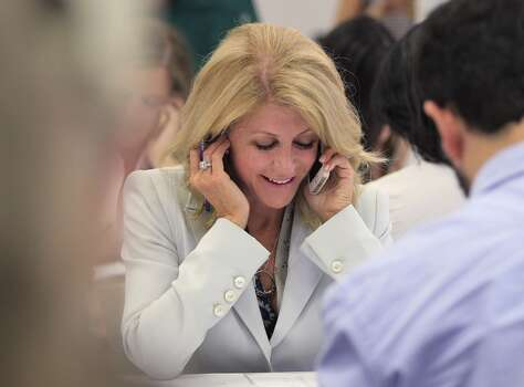 Texas Democratic gubernatorial candidate Wendy Davis works at her phone bank in La Gran Plaza in Fort Worth, Texas on Tuesday, July 8, 2014. Davis stopped by to speak out about Texans' right to know where hazardous chemicals are stored in their communities. (AP Photo/Fort Worth Star-Telegram, Ron T. Ennis) Photo: Ron T. Ennis, Associated Press