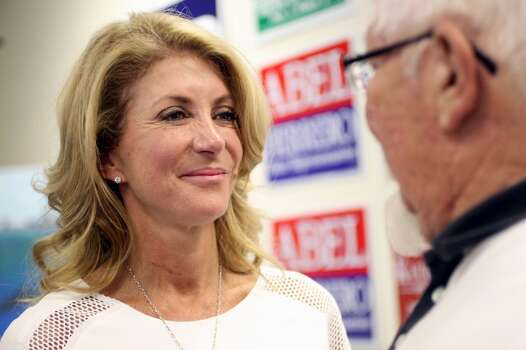 Sen. Wendy Davis talks with a supporter Thursday, July 24, 2014 as she stops by the Nueces County Democratic Party headquarters to greet campaign phone bank volunteers in Corpus Christi, Texas. The gubernatorial candidate was in town to attend the Minority Advancement Project's annual shrimp boil fundraiser. (AP Photo/Corpus Christi Caller-Times, Michael Zamora) Photo: Michael Zamora, Associated Press