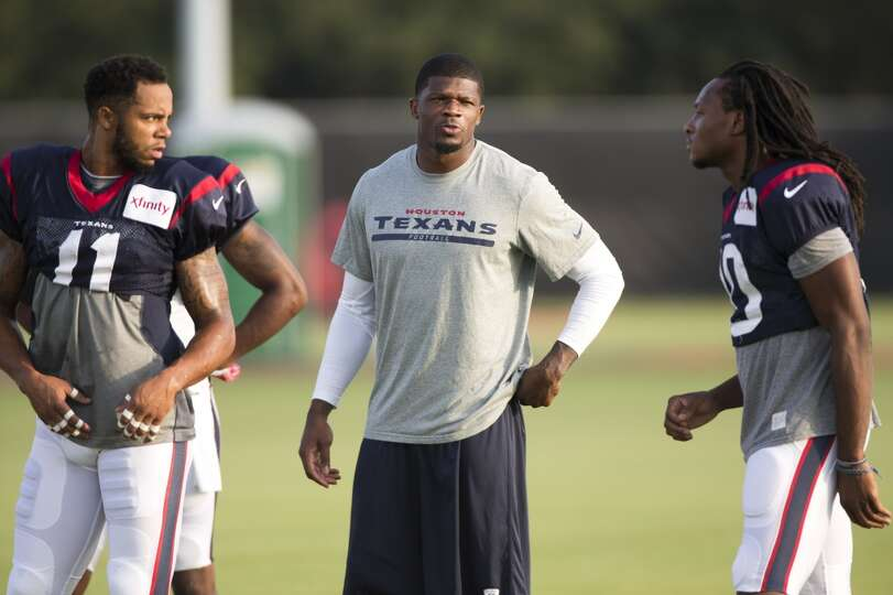 Day 4: July 29   Wide receivers DeVier Posey (11), Andre Johnson an