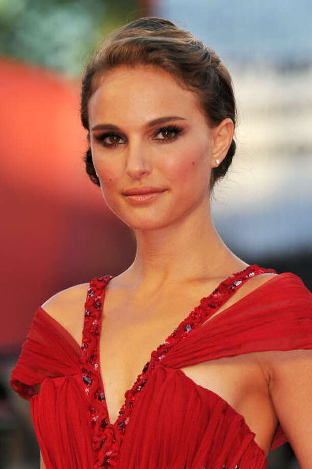 "Natalie Portman has been published twice in scientific journals. The ""Black Swan"" lead has a bachelor's degree from Harvard and speaks six languages. As she once told the New York Post, ""I'd rather be smart than a movie star."" Photo: Pascal Le Segretain, Getty Images / 2010 Getty Images"