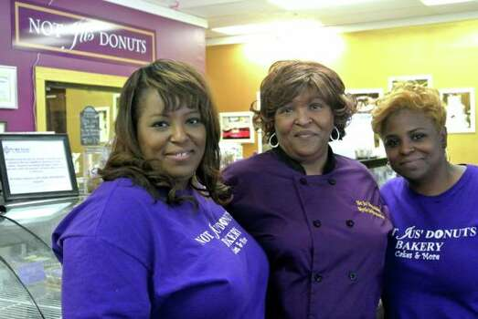 Andrea Jackson, left, her mother, Myrtle Zachary Jackson, and sister, Rosharon Cotton, run the family-owned Not Jus' Donuts. (Photo courtesy of Andrea Jackson)
