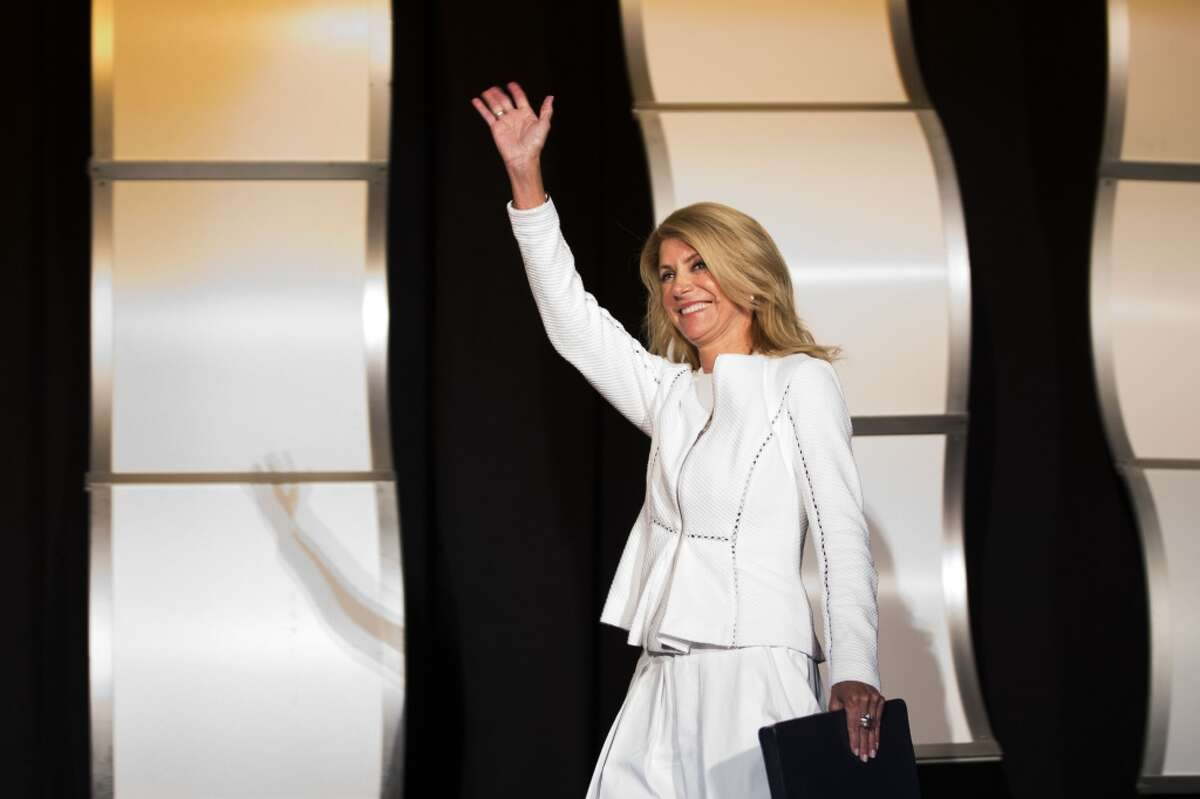State Sen. Wendy Davis, D-Fort Worth, waves as she is introduced before speaking during the Texas PTA LAUNCH Summer Leadership Seminar at the Hilton Americas on Saturday, July 19, 2014, in Houston. Davis is a candidate for Texas governor. ( Brett Coomer / Houston Chronicle )
