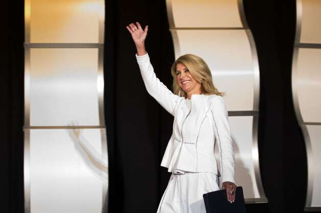 State Sen. Wendy Davis, D-Fort Worth, waves as she is