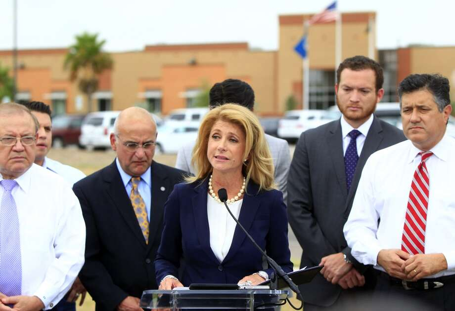 State Sen. Wendy Davis talks to the media after touring the McAllen Border Patrol station, Monday June 23, 2014, in McAllen, Texas. Several elected officials from the Rio Grande Valley attended the tour with Davis. Davis is asking Gov. Rick Perry to declare a state of emergency along Texas' border with Mexico amid a surge of unaccompanied minors pouring into the U.S. (AP Photo/The Monitor, Gabe Hernandez) Photo: Gabe Hernandez, Associated Press