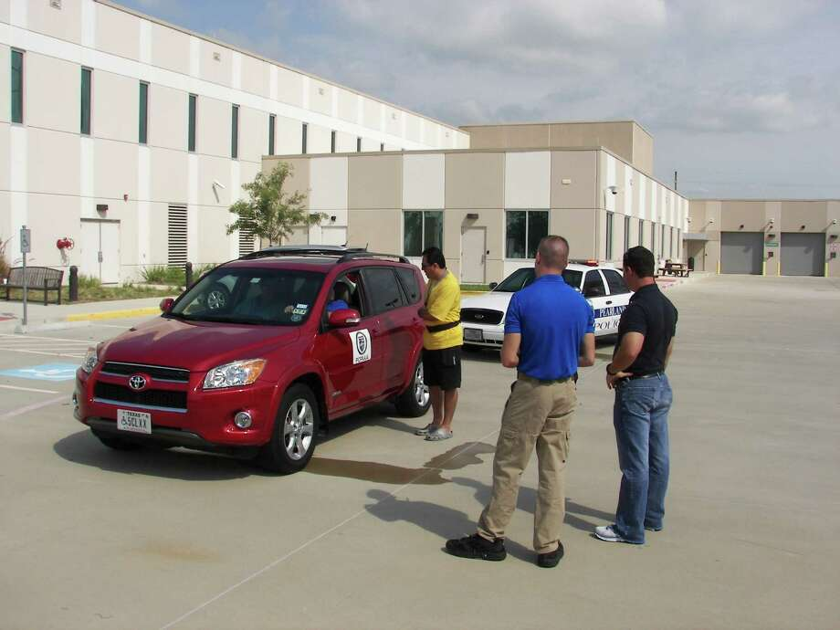 Citizen Police Academy participant Gilberto Romero takes part in a mock traffic stop as officers Daniel Hamminga, left, and Clint Pledger watch. Photo: Courtesy Pearland Police Department