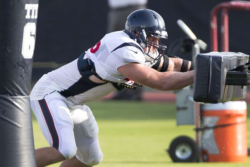 Day 4: July 29   Defensive end J.J. Watt hits a blocking sled.