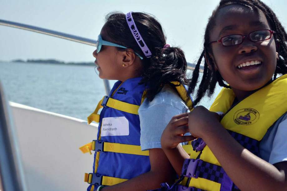 Ashwka Ravindranth, left, and Nadjasmine Rei took part in the annual Boat Camp off the coast of Darien on July 25. Photo: Megan Spicer / Darien News