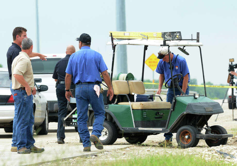 Jefferson County Sheriff's deputies retrieve a golf cart that was stolen Tuesday morning by an inmate shortly after his release. The man also attacked a maintenance worker and stole a Sheriff's vehicle. Photo taken Tuesday, July 29, 2014 Guiseppe Barranco/@spotnewsshooter Photo: Guiseppe Barranco, Photo Editor