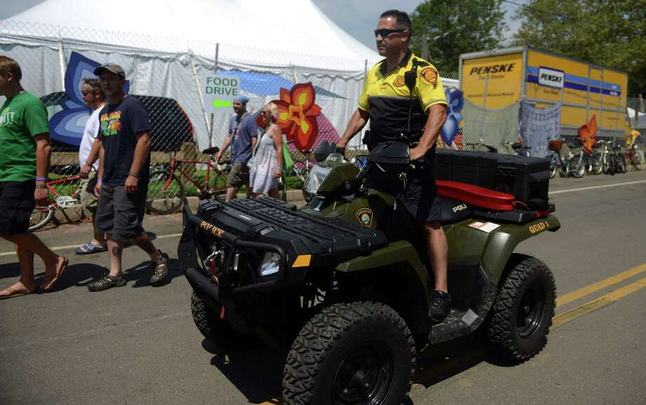 A Bridgeport police officer rides an ATV through the crowd at the 18th annual Gathering of the Vibes Musical Festival at Seaside Park in Bridgeport, Conn. Saturday, July 27, 2013. Photo: Autumn Driscoll / Connecticut Post freelance