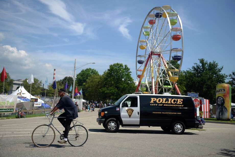 A police van patrols the grounds of the 18th annual Gathering of the Vibes Musical Festival at Seaside Park in Bridgeport, Conn. Saturday, July 27, 2013. Photo: Autumn Driscoll / Connecticut Post freelance