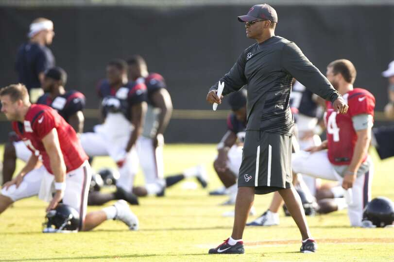 Day 4: July 29   Texans general manager Rick Smith watches warm ups