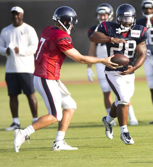 Day 4: July 29   Texans quarterback Case Keenum hands the football