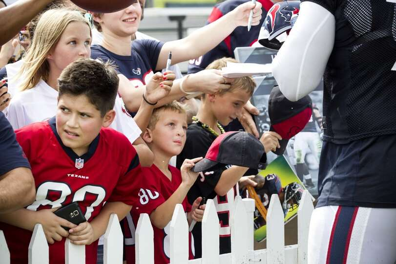 Day 4: July 29   Texans fans wait for an autograph from tackle Duan
