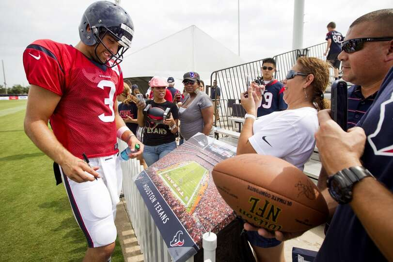 Day 4: July 29   Texans quarterback Tom Savage signs autographs.