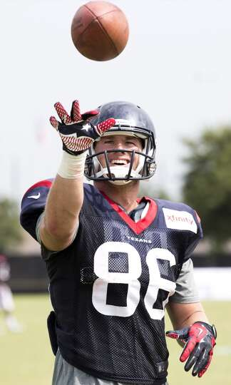 Day 4: July 29   Texans tight end Zach Potter tosses a football.